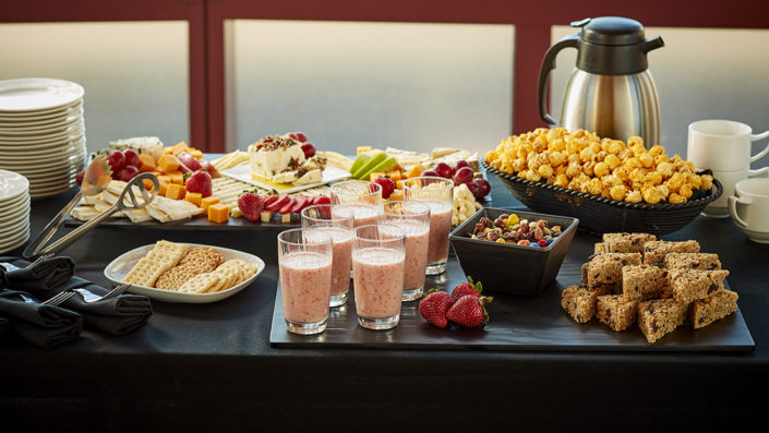 Break station with cheese platter, smoothies, fruit, granola bars, beverages