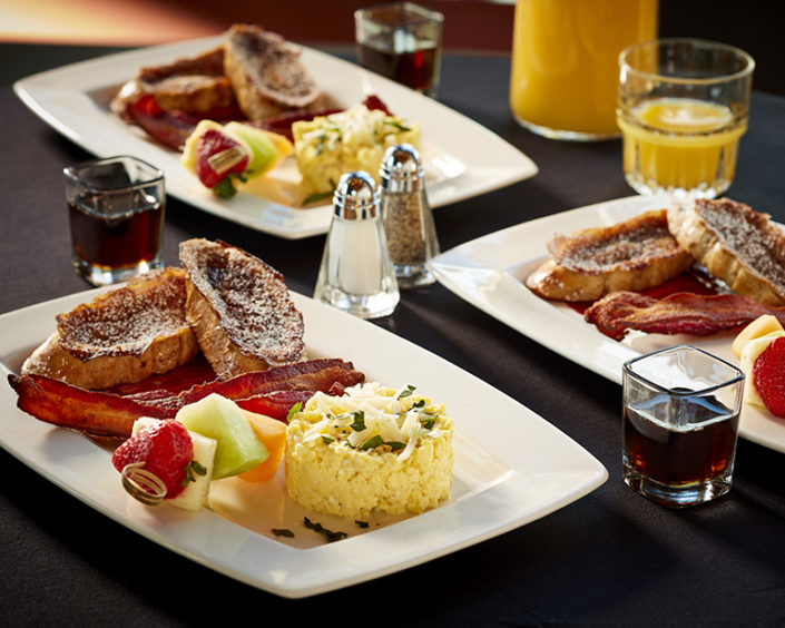 French Toast and Scrambled Egg Breakfast Plate with bacon and fruit
